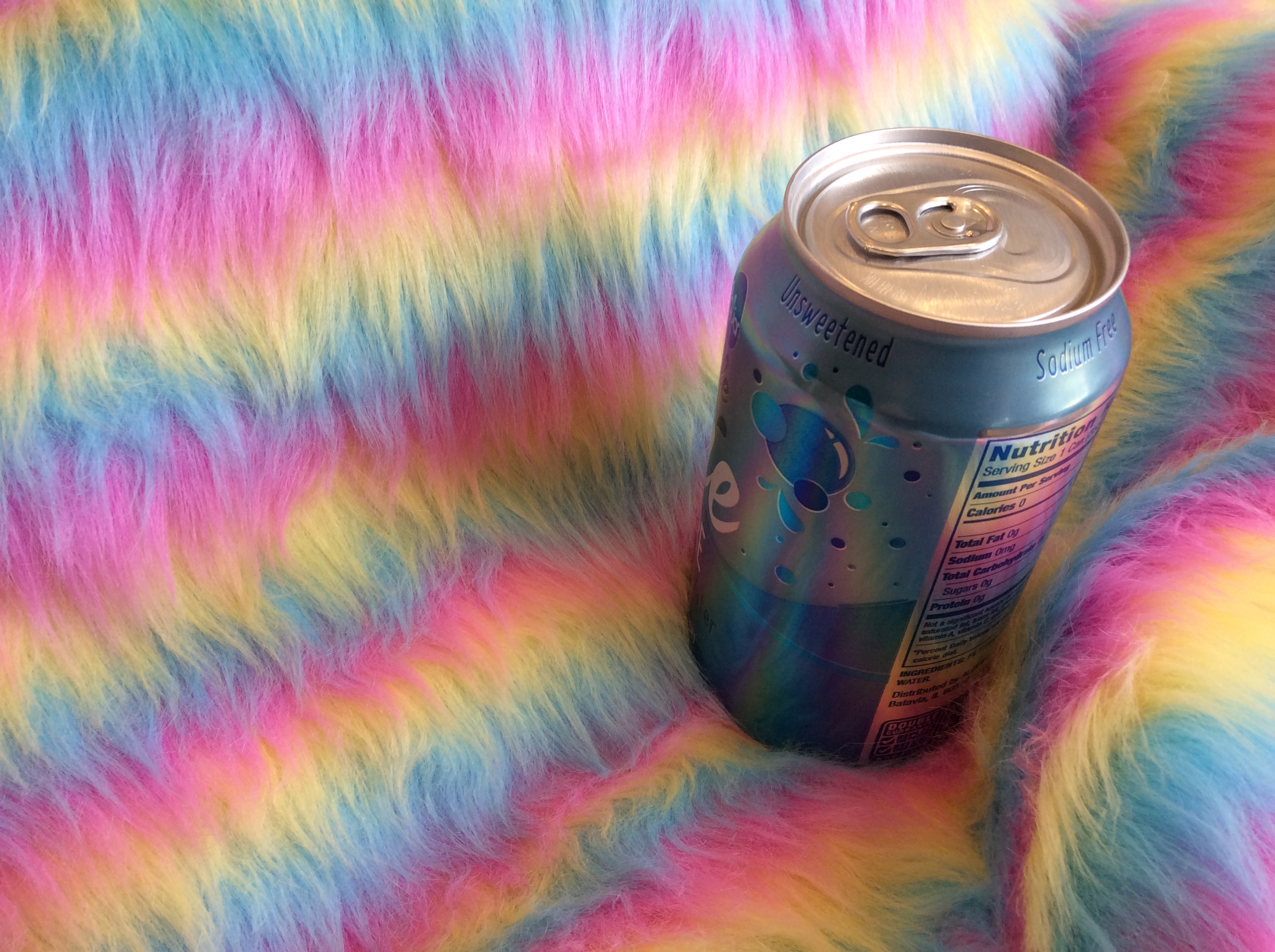 Striped faux fur with seltzer can for scale