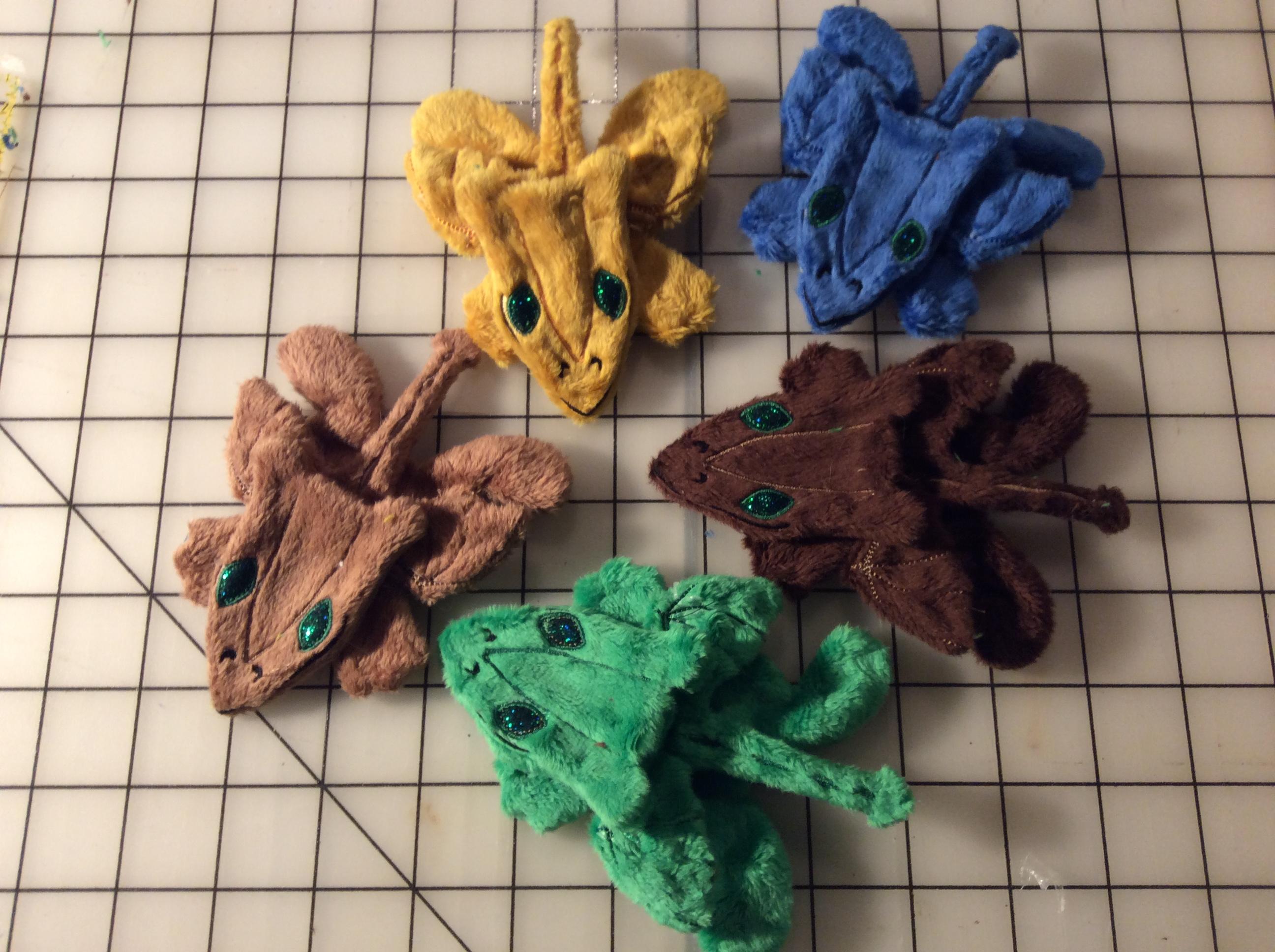 Five plush dragons, awaiting stuffing.