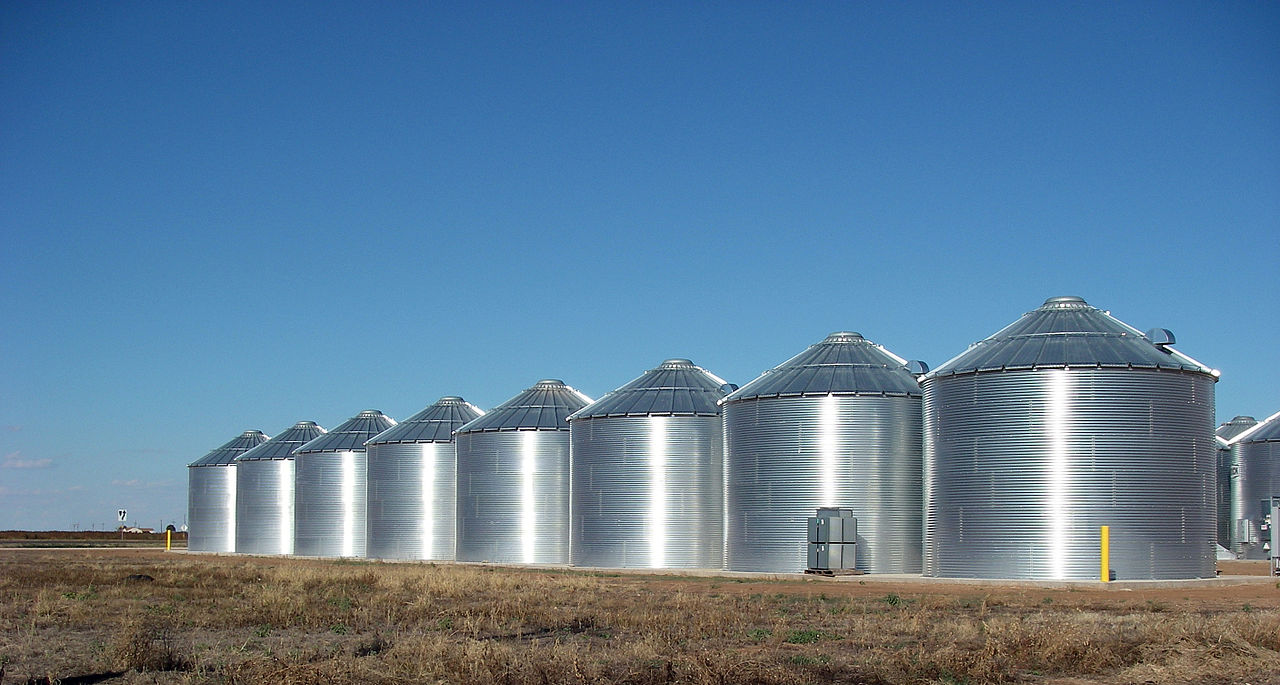 Steel silos storing sunflower seed along the west side of the small West Texas town of Ralls, Texas.